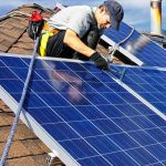 Electrician installing blue solar panels on residential home - Electrician Sunshine Coast